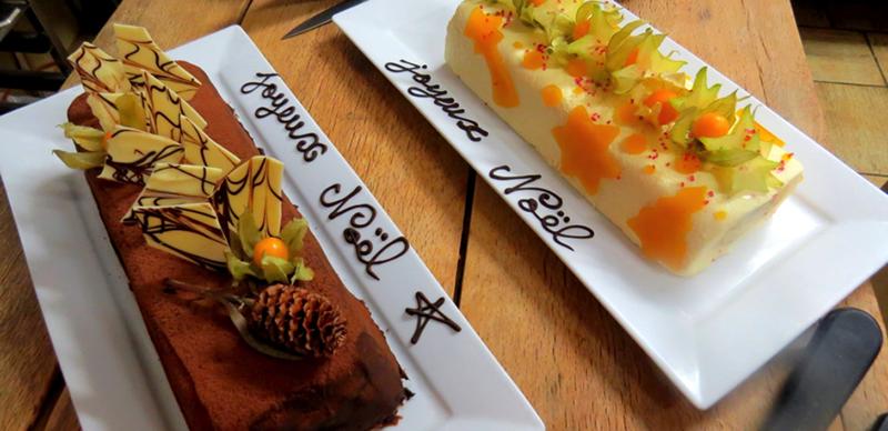 Royal aux chocolat et pralin / Bûche chocolat blanc, fruit de la passion et kiwi.